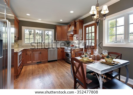 Kitchen in suburban home with cherry wood cabinetry - stock photo