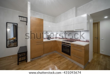 Kitchen in the interior of the studio apartments.