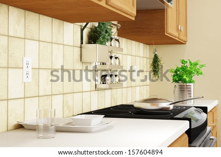 Kitchen interior closeup with herbs and dishes - stock photo