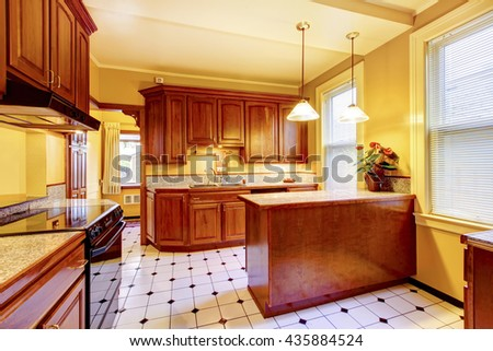 Kitchen interior design with island, granite counter top and tile floor