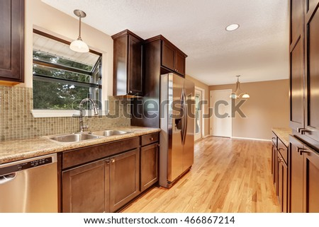 Kitchen interior with brown cabinets and granite tops. Northwest, USA