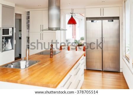 kitchen interior with kitchen island - stock photo