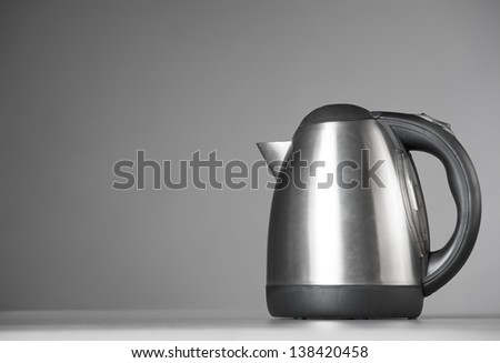Kitchen Kettle on a gray background. Closeup - stock photo