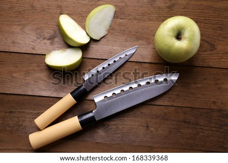 Kitchen knives  on wooden background - stock photo