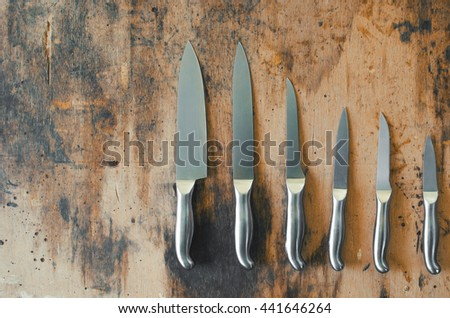 Kitchen knives set on the wooden desk - stock photo