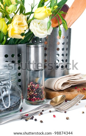 Kitchen objects, cookware, tableware, flowers and spices on a white background. - stock photo
