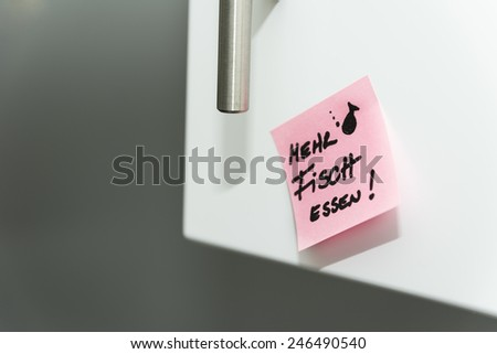 Kitchen, Post-it note, eat more fish - stock photo