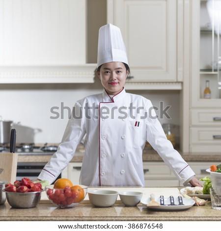 Kitchen preparations Chinese woman  - stock photo