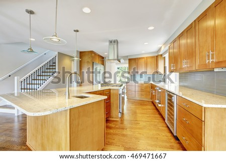Kitchen room interior with wooden cabinets, granite counter top and island. Northwest, USA