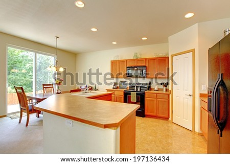 Kitchen room with dining area and walkout deck. View of cabinet with counter top