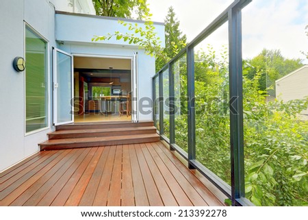 Kitchen room with exit to screened walkout deck with wooden floor. - stock photo