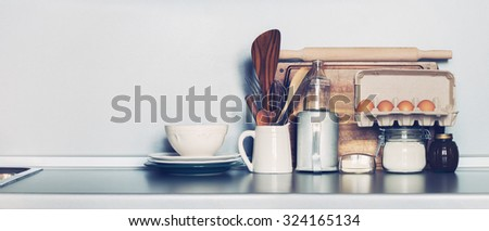 Kitchen Rustic Dishes, Table ware, Fresh Grocery and other Different Stuff on Grey Background. Toned Image with copy space - stock photo