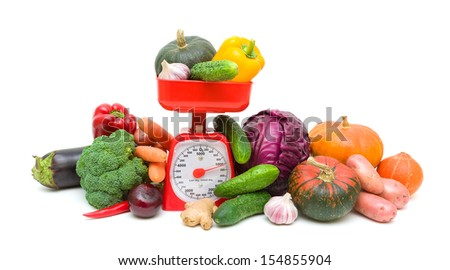 Kitchen scales and fresh ripe vegetables isolated on a white background. horizontal photo. - stock photo