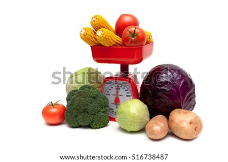 kitchen scales and fresh vegetables isolated on white background. horizontal photo.