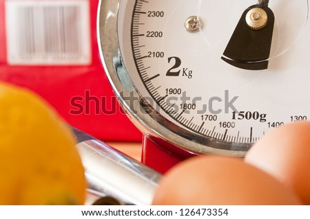 Kitchen scales for baking - stock photo