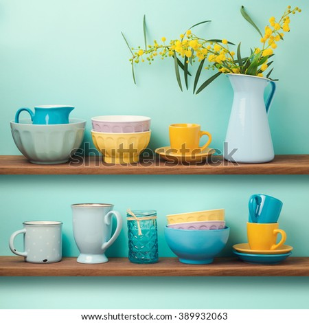 Kitchen shelf with cups and dishes