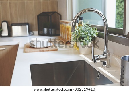 Kitchen sink and faucet - stock photo
