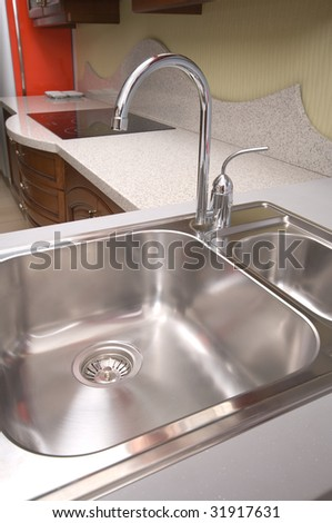 Kitchen Sink and Faucet.Washing Dishes.