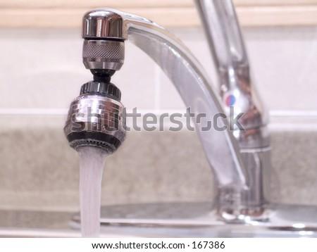 Kitchen sink water tap - stock photo