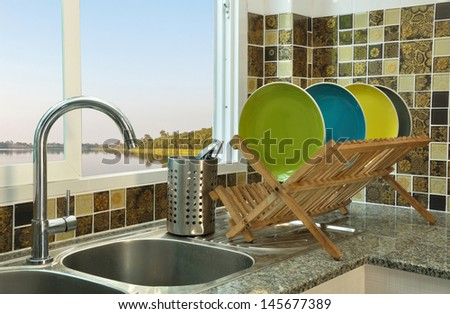 Kitchen sink wooden plate rack asian stock photo 145677389 for Japanese style kitchen sink