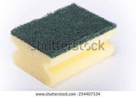 Kitchen sponge isolated on white background. Image with shallow depth of field. - stock photo