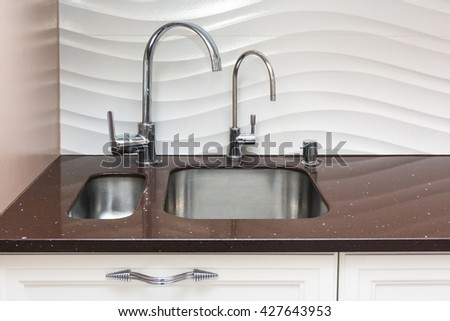 Kitchen stone counter with undermount build-in sinks, mixers and soap dispenser
