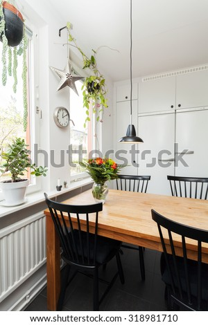 kitchen table by the window - stock photo