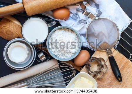 Kitchen Table Top Preparation Baking Process Wooden Metal Dishes Ware Fresh Grocery Different Stuff Top View - stock photo