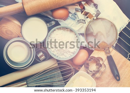 Kitchen Table Top Preparation Baking Process Wooden Metal Dishes Ware Fresh Grocery Ingredient Top View Toned - stock photo