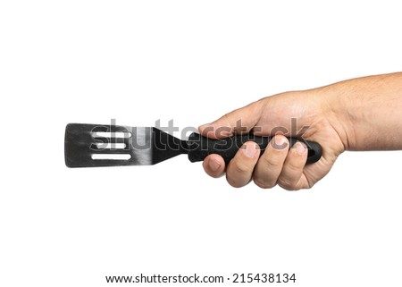 kitchen tool in hand on a white background - stock photo