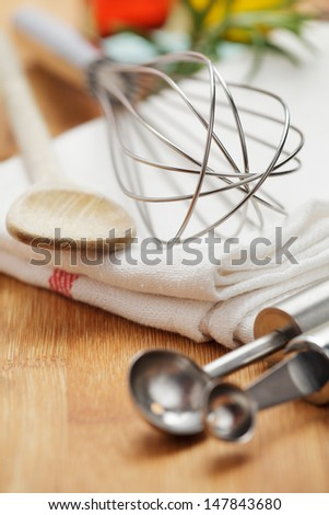 Kitchen tools on a wooden plate