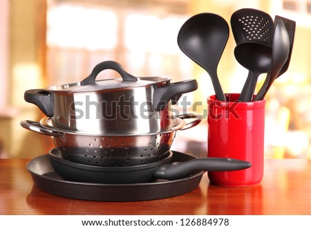 kitchen tools on table in kitchen - stock photo