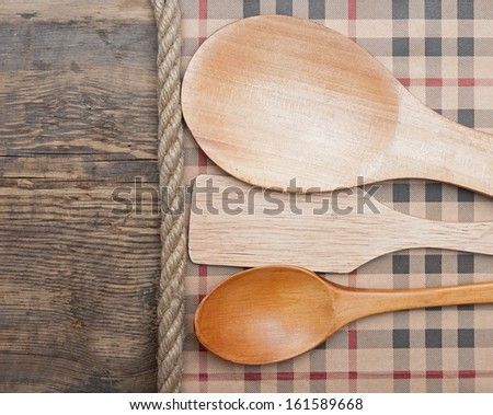 kitchen tools on vintage wooden background. - stock photo