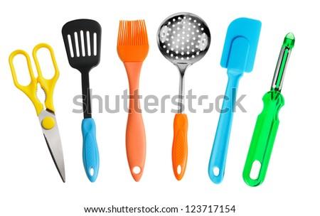 Kitchen tools. Scissors, blade, brush, skimmer, potato peeler. Isolated on white. - stock photo