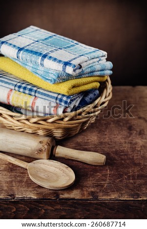kitchen towels on a wooden table. Photographed close-up - stock photo