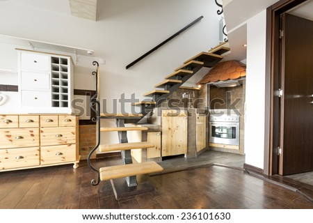 Kitchen under the stairs - stock photo