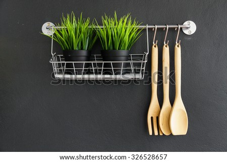kitchen utensil hang on black stone wall