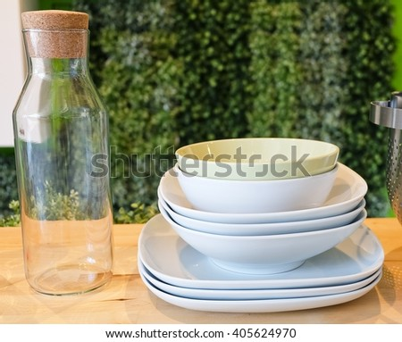 Kitchen Utensil, Set of Ceramic Dishes, Bowls, Plates and Glass Bottles Preparing for Serve Hot and Cold Food. - stock photo
