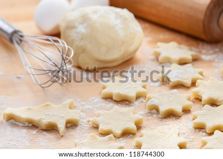 Kitchen utensil with raw Christmas cookies. Baking biscuits. - stock photo