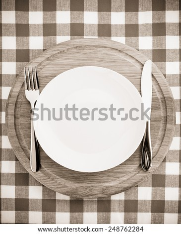 kitchen utensils at cutting board on napkin background