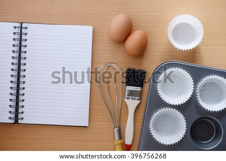 kitchen utensils for making muffin and notebook for write recipe. - stock photo