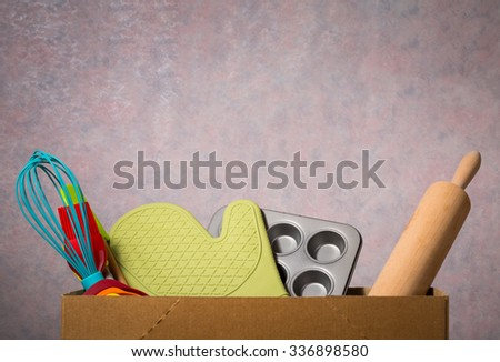 kitchen utensils in cardboard - stock photo