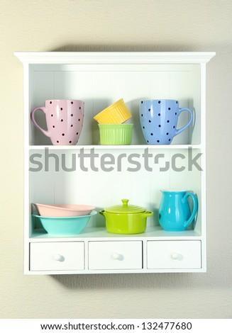 Kitchen utensils on beautiful white shelves - stock photo
