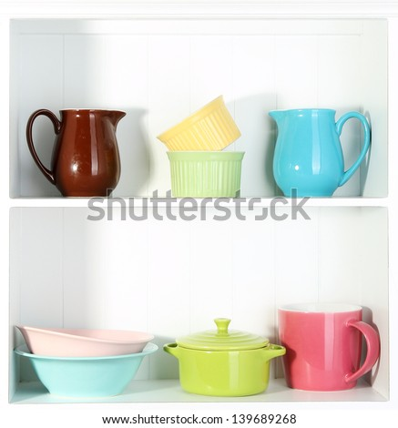 Kitchen utensils on beautiful white shelves - stock photo