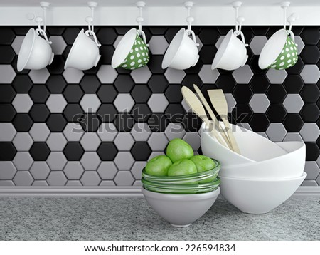 Kitchen utensils on the marble worktop. Ceramic and glass kitchenware in front of modern wall tile. - stock photo
