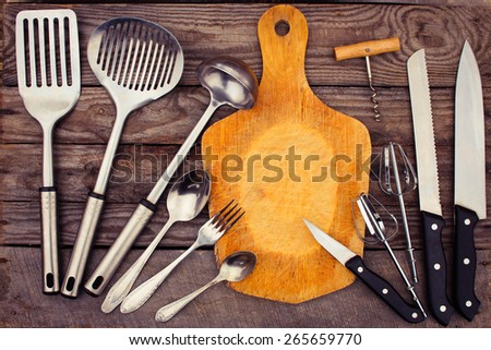 kitchen utensils on wooden background. Toned image.  - stock photo