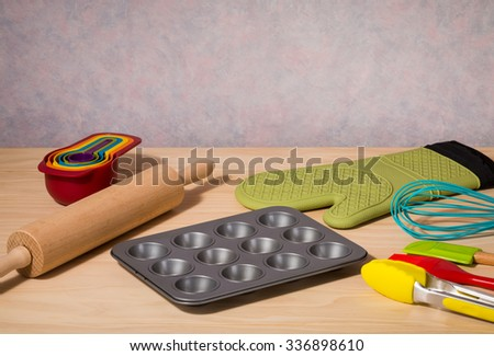 kitchen utensils on wooden table - stock photo