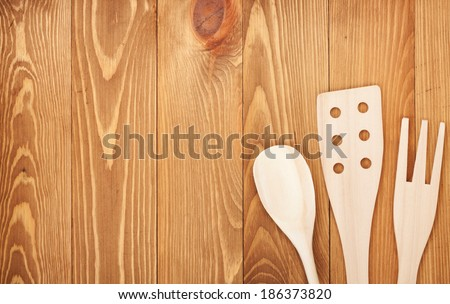 Kitchen utensils on wooden table background. View from above with copy space - stock photo