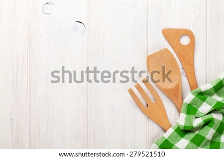 Kitchen utensils over white wooden table background. View from above with copy space  - stock photo