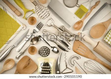 Kitchen utensils set on wooden texture background - stock photo
